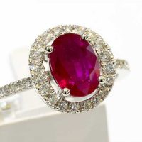 Bague 1 rubis entourage diamants or 18 cts